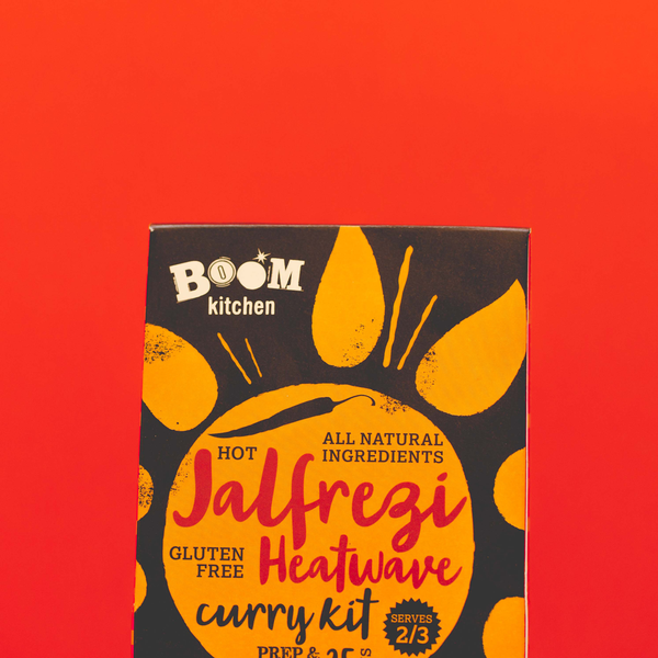 Boom Kitchen's Jalfrezi Heatwave curry kit on bright orange background