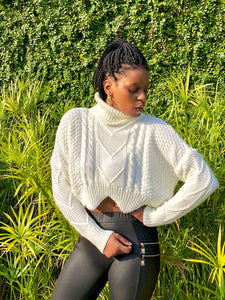 Ivory cable knit crop sweater with turtle neck detailing