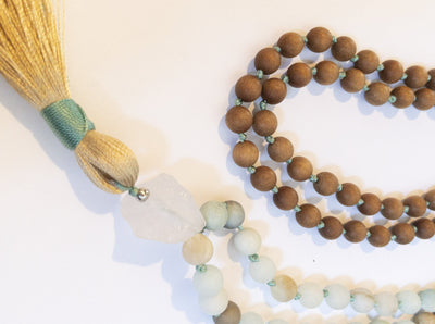crystal vault cobalt spirituality eco-friendly sustainable products support local makers wooden mala bead necklace tassel beads quartz crystal represent Mother Earth grounding effects stand stability reliability warmth often give nurturing motherly energy gorgeous piece hand-knotted worn variety outfits beachy casual formal setting handmade 108 composed natural stone feel centered
