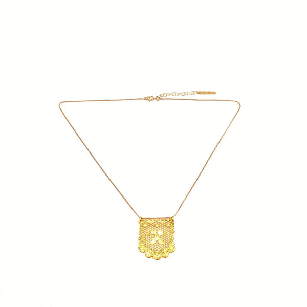 Small gold lace on a chain