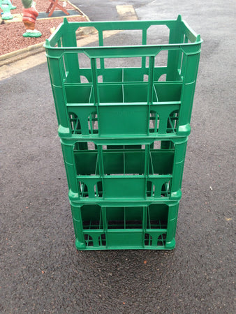Stacked Green Milk Crates to Hold 8 x 2ltr Milk Bottles or Cartons
