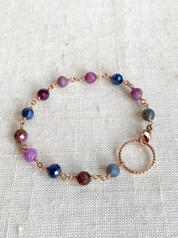 B1984 - rose gf twisted link with multi color ruby/sapphire bracelet