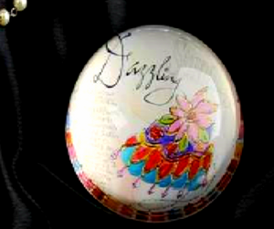 "JOYCE SHELTON GLASS PAPERWEIGHT WITH ""DAZZLING"" DESIGN"