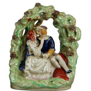 Staffordshire Reproduction Kissing Couple Figurine