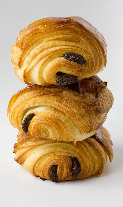 three croissants stacked on top of each other