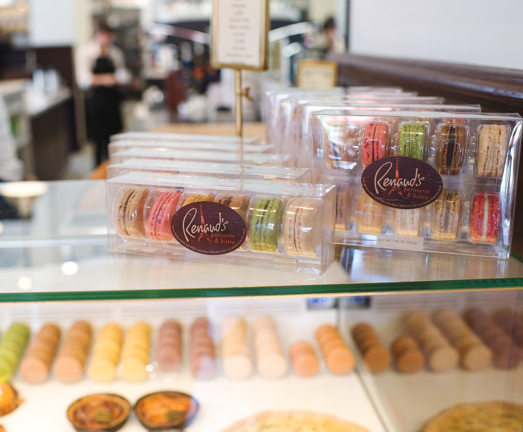 packaged cookies on counter display in Renaud's Patisserie