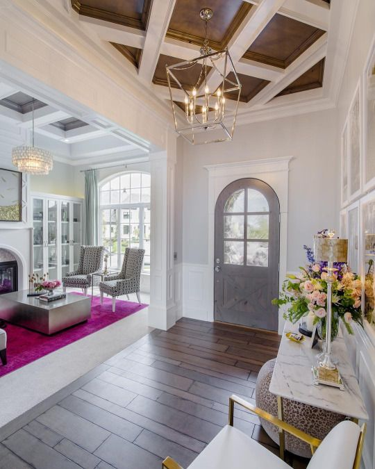 A Antiqued Grey Finish Lightens Wood Floors In This Elegant Entry