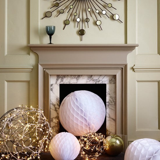 Who Knew A Mantel Decorated With Single Smoky Blue Goblet Could Speak Of The Holidays Little Assist From Wire Globes Covered In Strings Tiny
