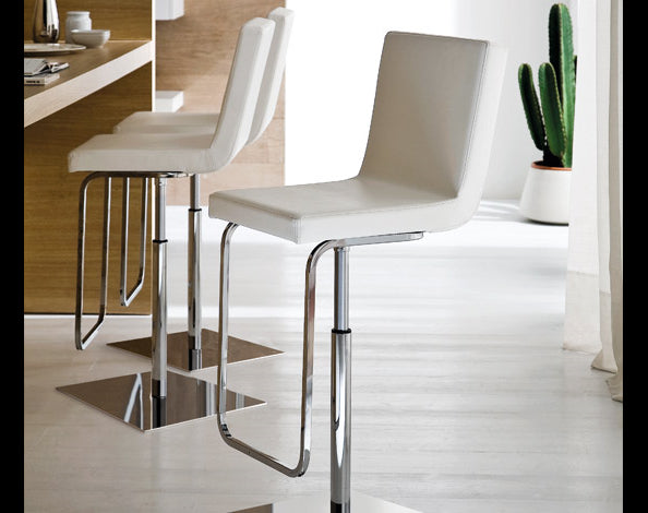 Leatherette upholstered Piston swivel stools in white by Domitalia