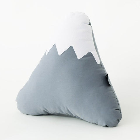 grey and white mountain shaped pillow
