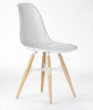ZigZag modern dining chair with solid white shell and ashwood base