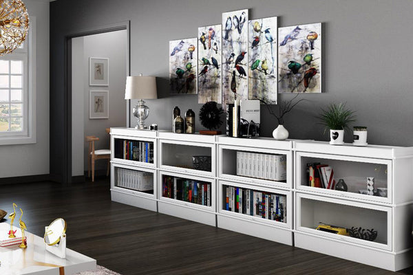 Hale Barrister Bookcases in four stacks with 2 shelf sections per stack in the living room.