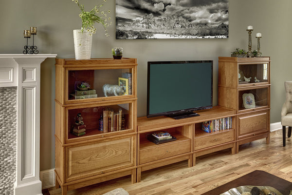 Arrange stacking interchangeable Barrister Bookcases with receding doors in the family room.