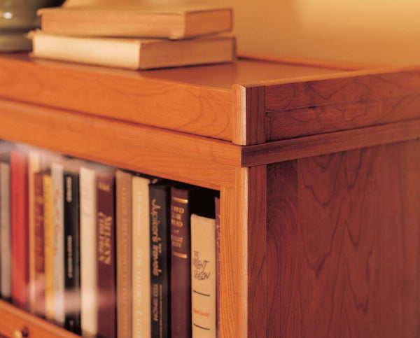 Barrister Bookcase glass door shelf section protects treasured books.