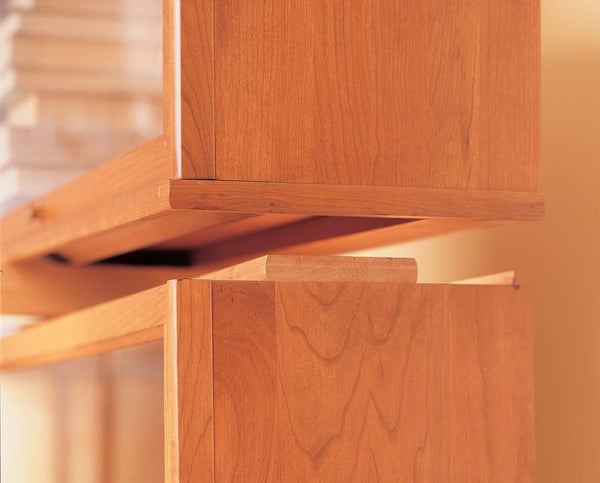 Hale Barrister Bookcase shelf sections stack and interlock for a customizable height.
