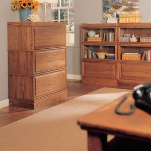 Hale Bookcases 3 Drawer Lateral File in Oak in office