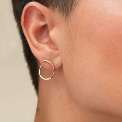 Picture of Esme Loop Gold Hoop Earrings on body  White Space Jewelry