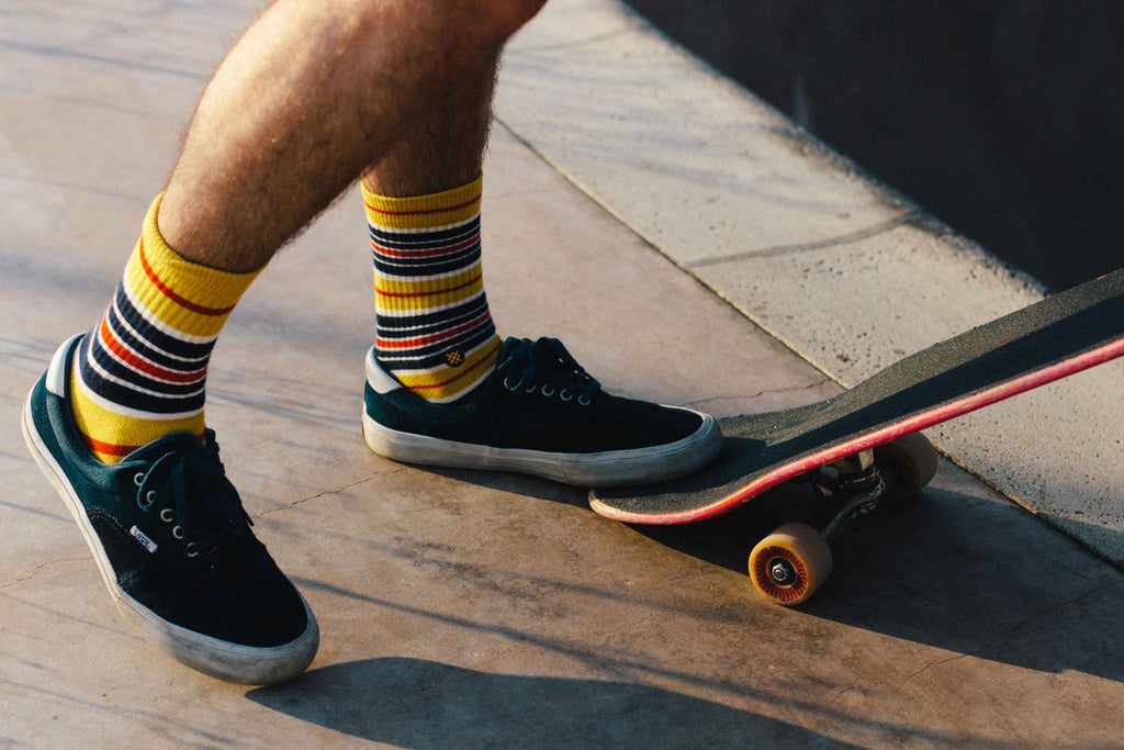 Close up of skateboarder's shoes and socks.