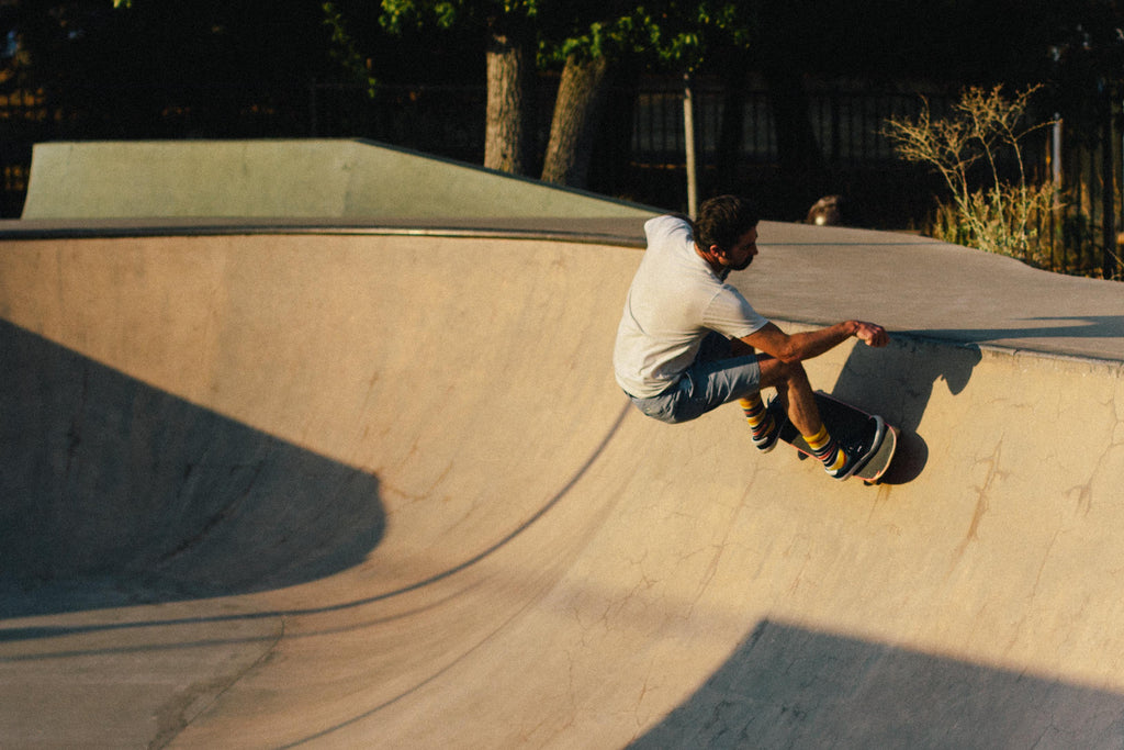 Skateboarder riding a bowl.