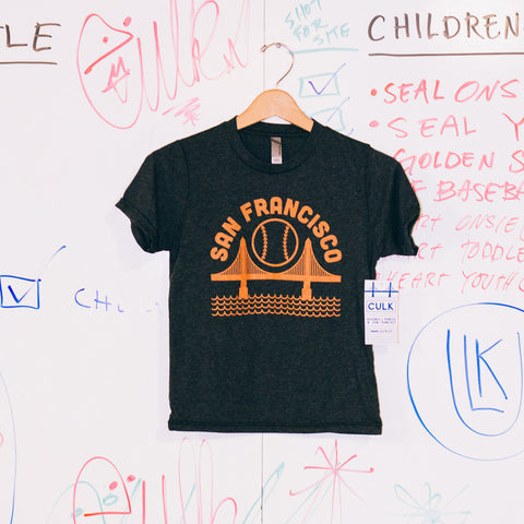 a triblend black youth tee shirt featuring an orange san francisco baseball graphic