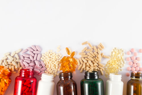 Many colorful bottles of vitamins that help with memory