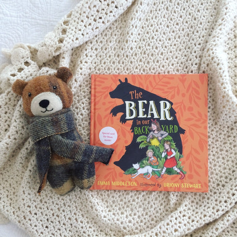 childrens story book with little bear, made from vintage woollen blankets and 100% organic wool stuffing, with a sweet hand embroidered face. brown woollen blanket and the bear in our backyard book gift set