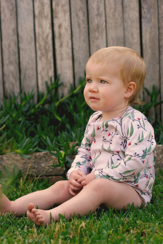 Our Organic baby onesies are super soft and made from 100% GOTS Certified Organic Cotton. Make a bold statement in our unique Gum Blossoms print. Derived from our original hand drawn graphics and printed with water based inks  Featuring Australian Gum Blossoms and leaves, Super comfy with a lap neckline to allow easy changing. 100% Australian Made making it the most unique Australian gift for someone little.