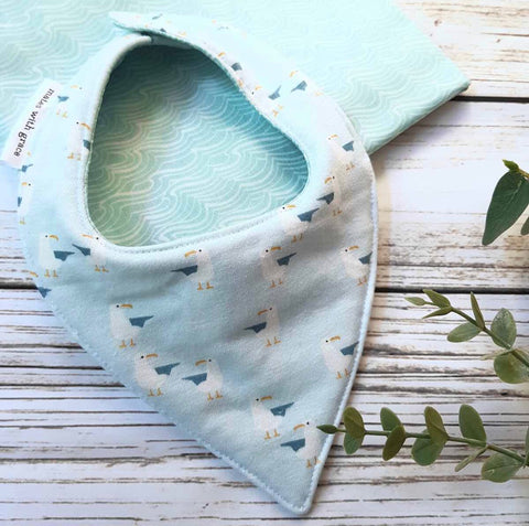 light blue seagull print bandana bib. Handmade in australia with 100 percent cotton. reverse side white wave print on light blue