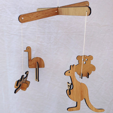 Wooden Australian animal mobile for nursery. Featuring an emu, kangaroo, koala and crocodile.