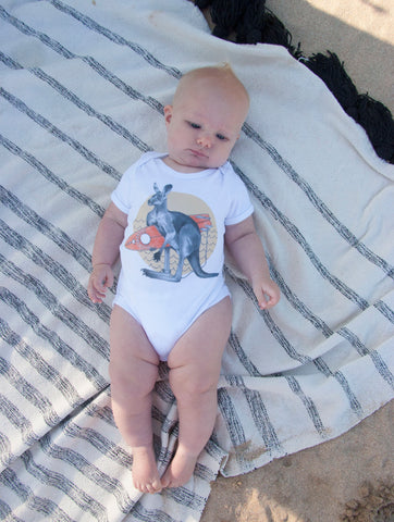 short sleeve baby onesie made in australia from organic cotton. featuring kangaroo with surfboard.