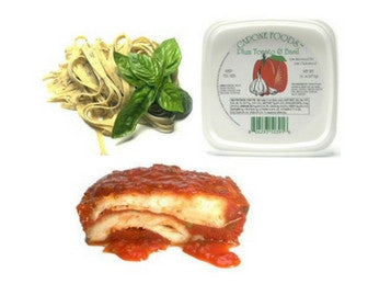 Chicken dinner with plum tomato and basil sauce and fresh ...