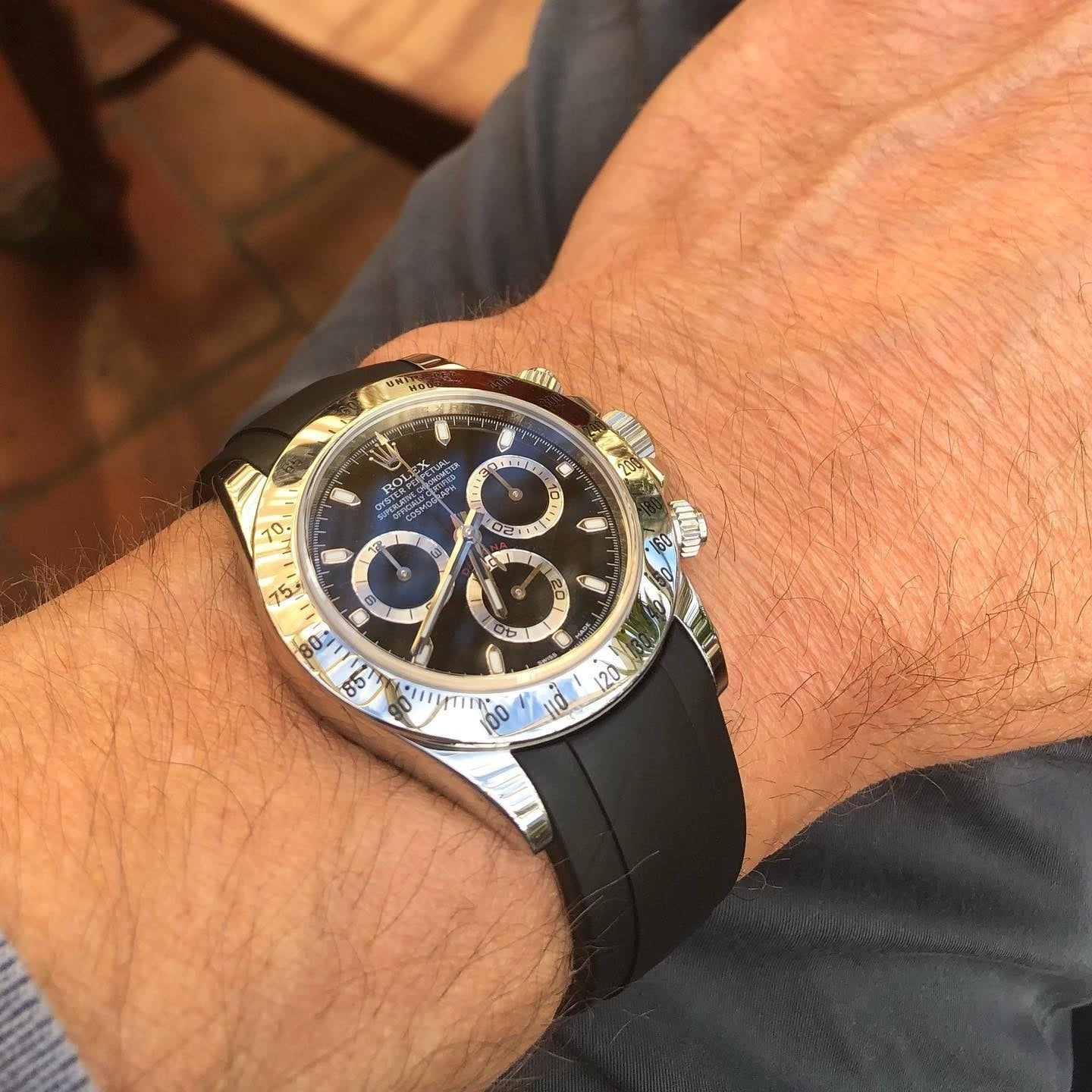 black rubber strap from everest bands on a rolex daytona watch with black dial