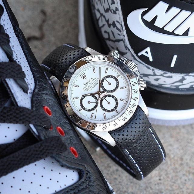rolex daytona on black perforated leather strap with white stitching