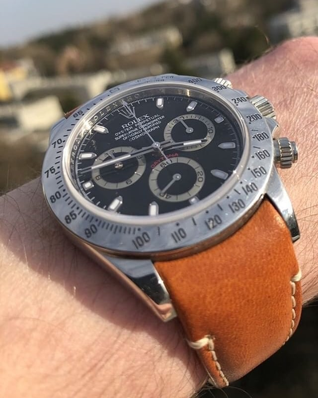 rolex daytona with black dial on tan leather curved end strap from everest bands
