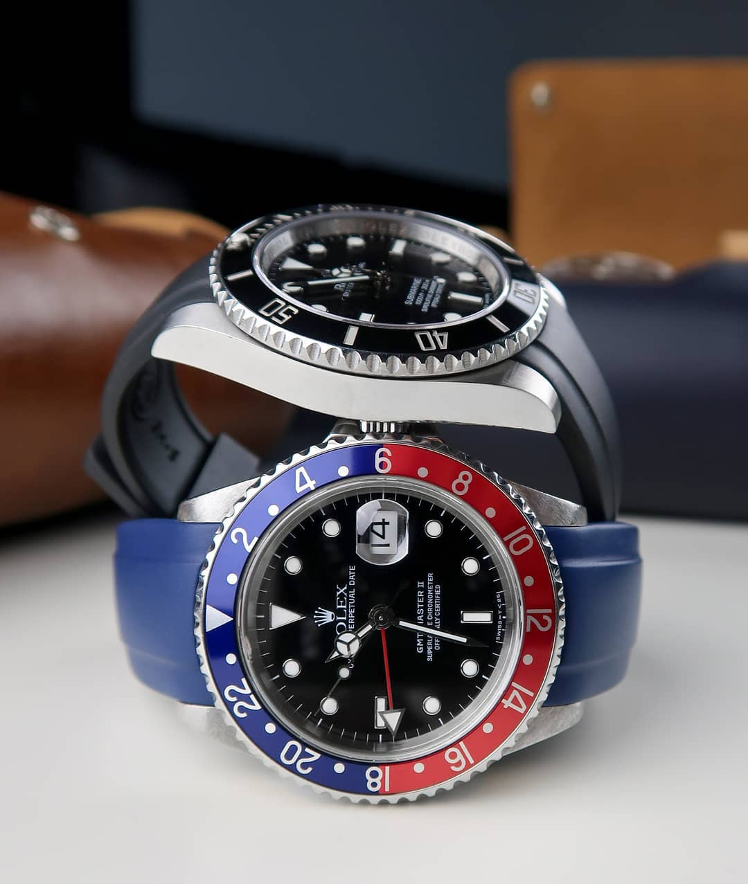 two rolex gmt master II watches on rubber straps