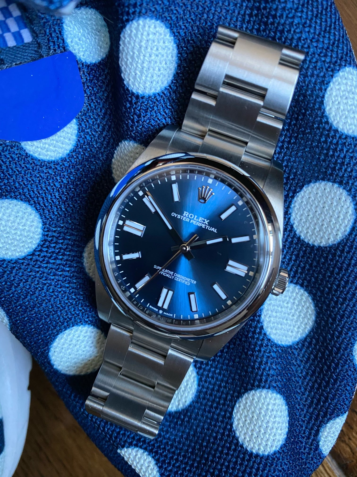 blue rolex oyster perpetual 41 on blue polka dot sneakers