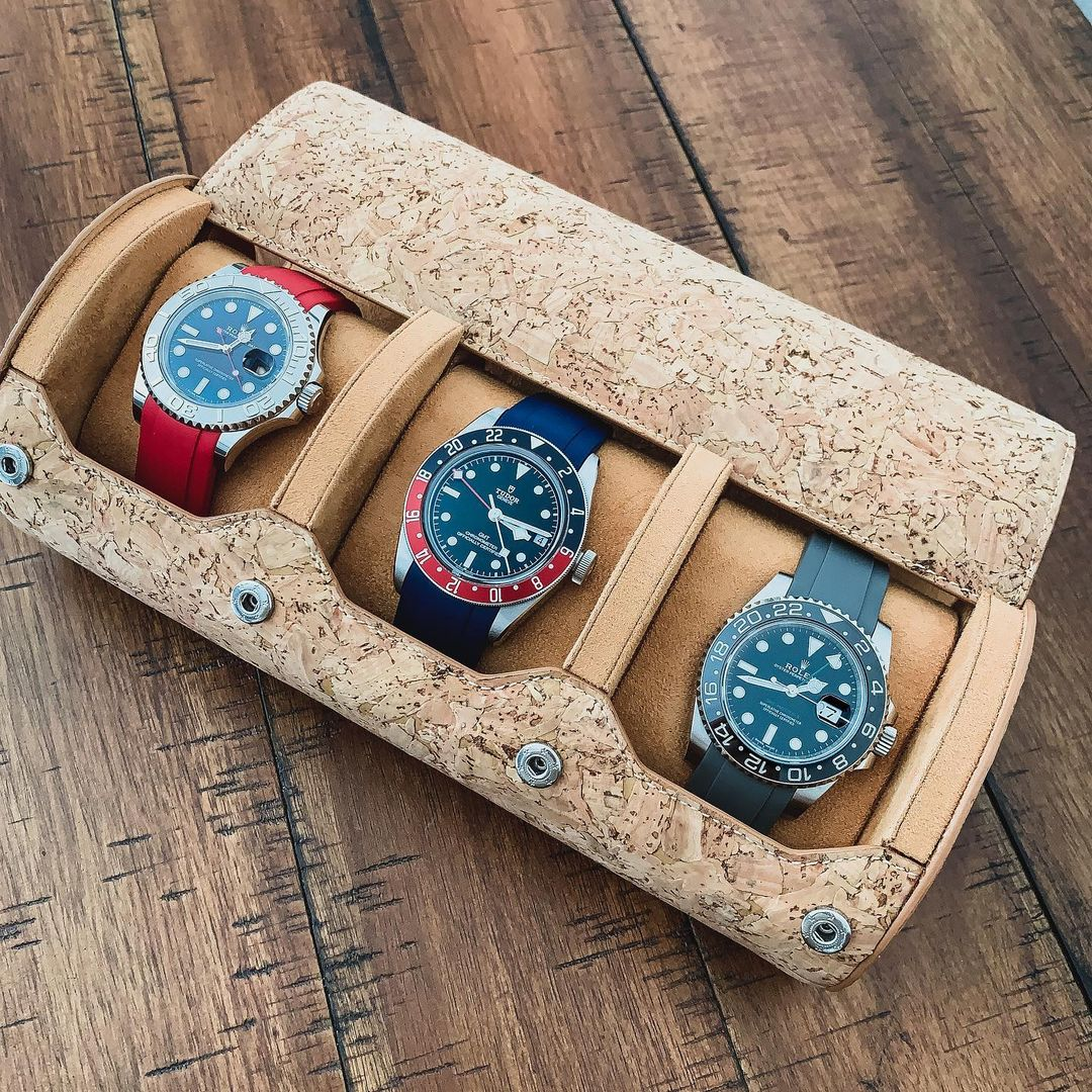 cork watch roll with 3 rolex watches inside