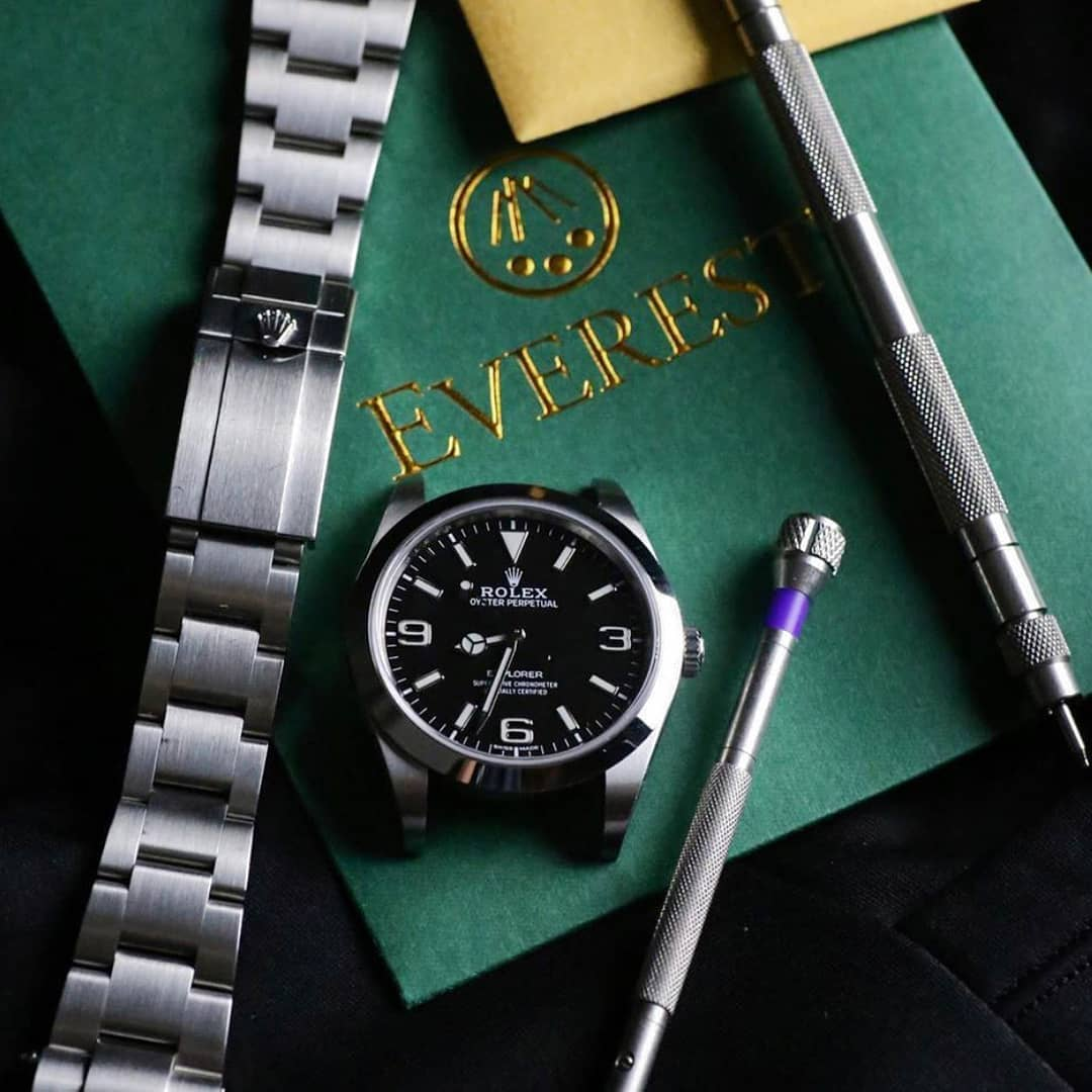 everest tool kit next to a disassembled rolex watch