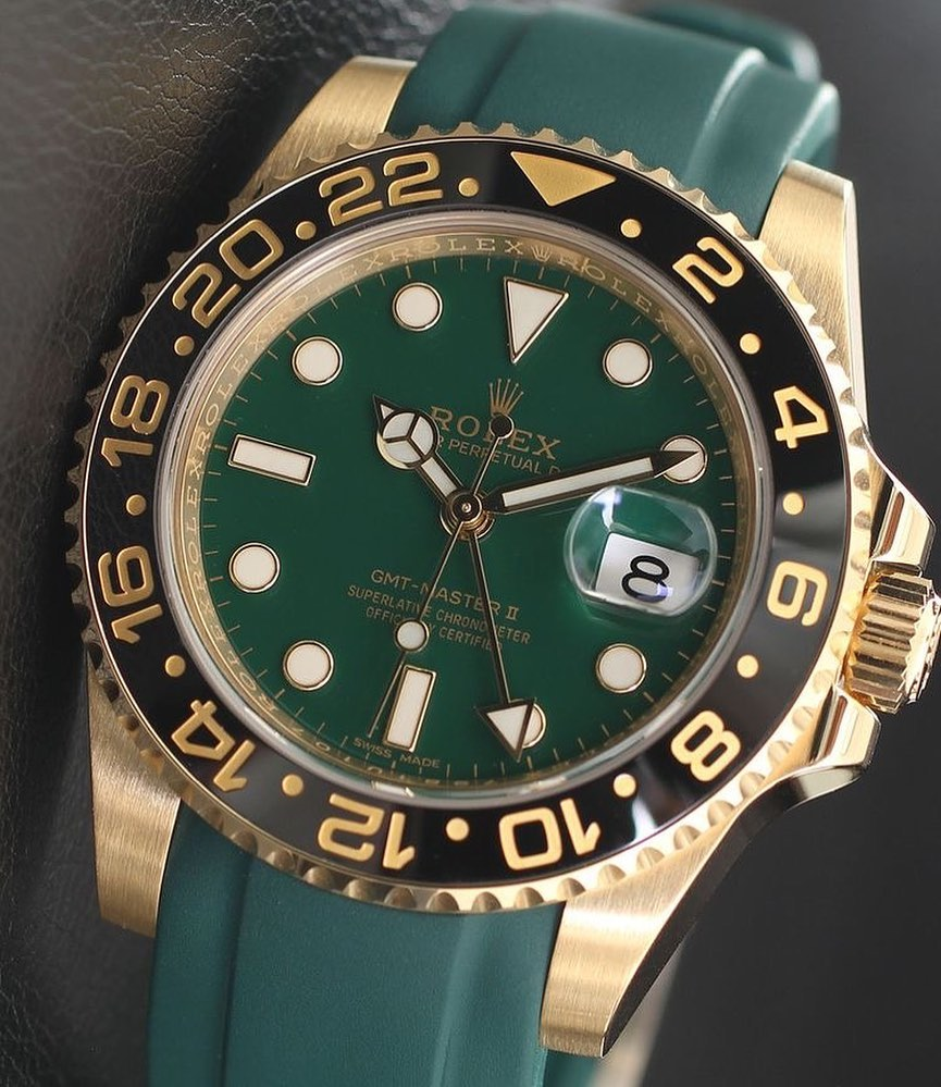 rolex gmt master in gold with green dial