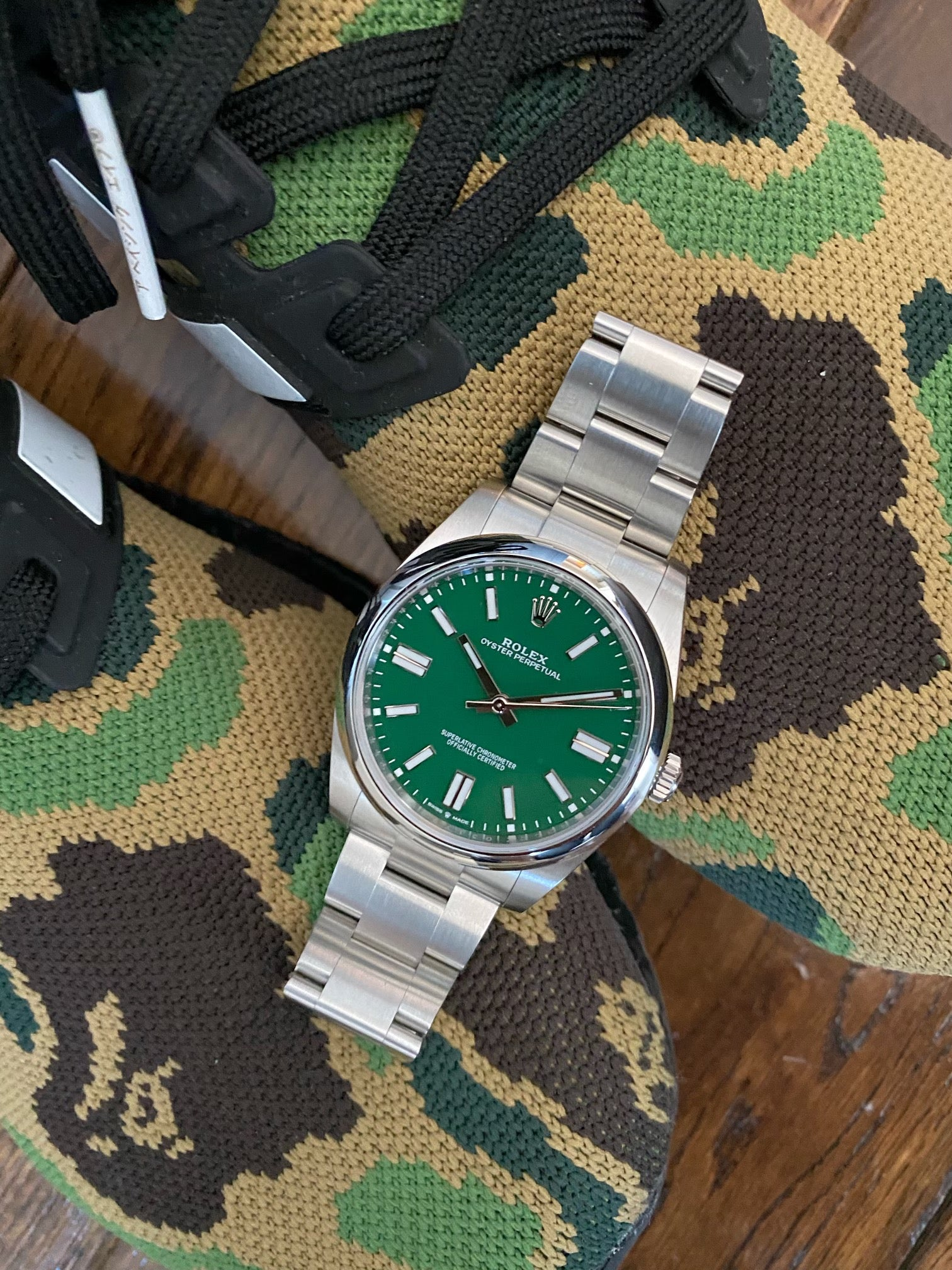 green rolex oyster perpetual with green camo sneakers