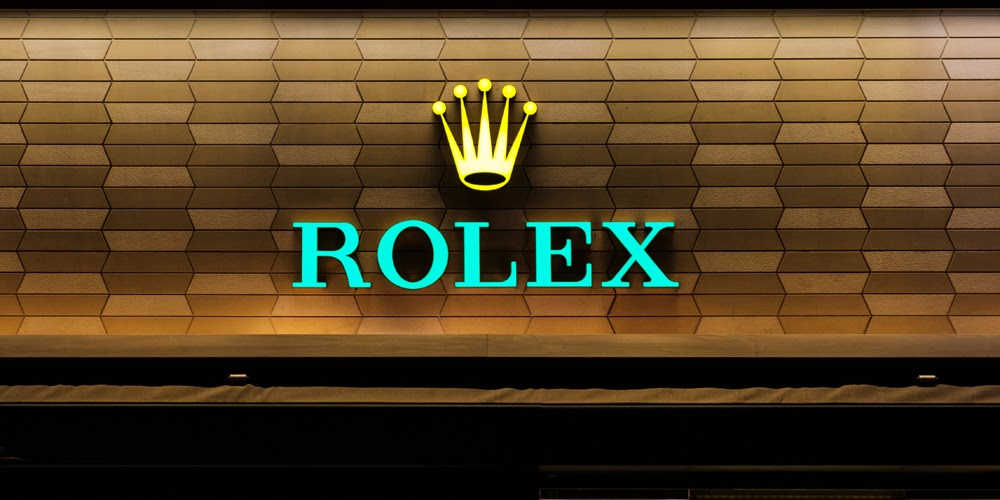 rolex sign on building