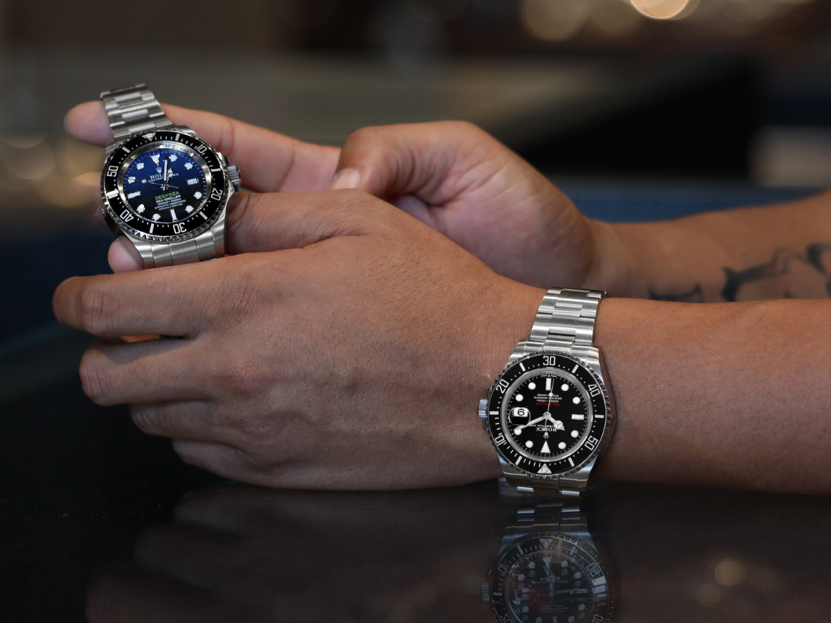 rolex watch in hands and on wrist