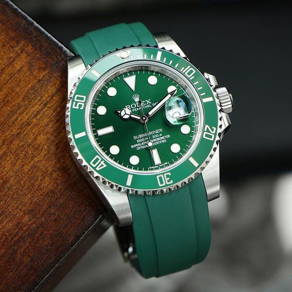 rolex hulk on green rubber strap hanging from table