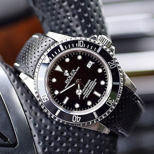 rolex submariner on leather racing strap