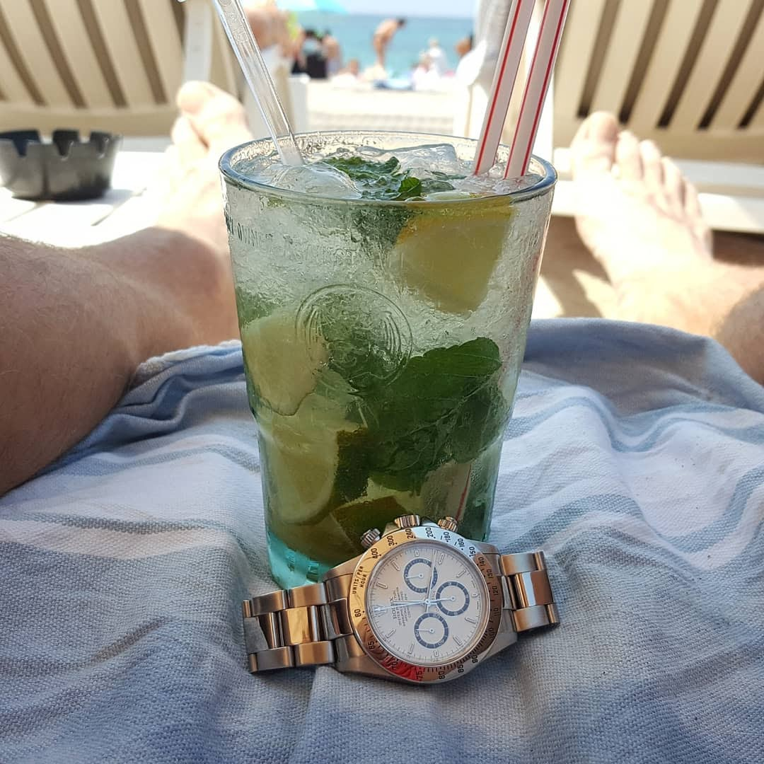 mojito and a rolex watch on beach