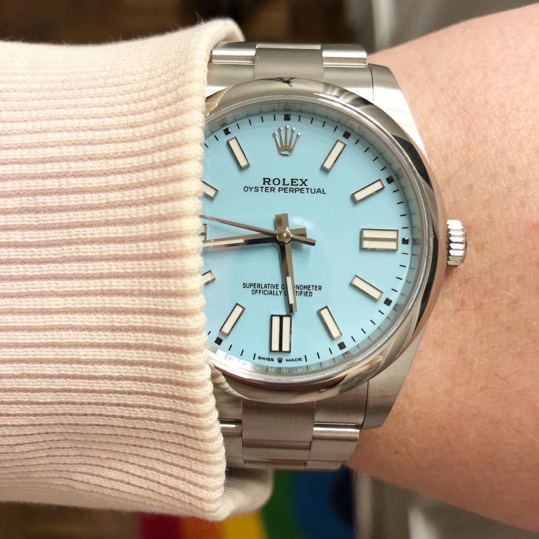 rolex oyster perpetual 41mm with turquoise dial on a wrist