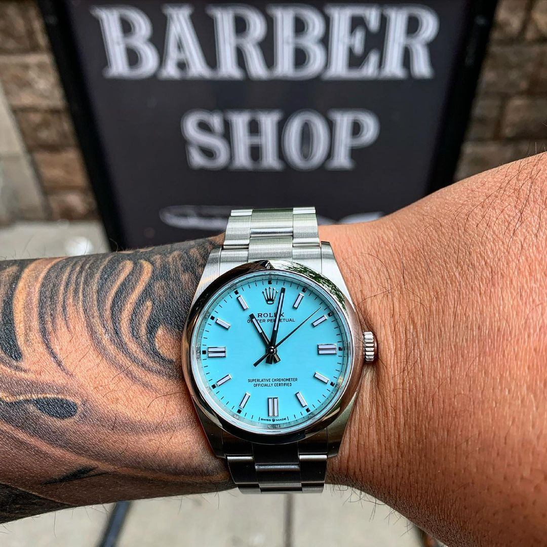 rolex op41 in turquoise onw wrist with tattoos