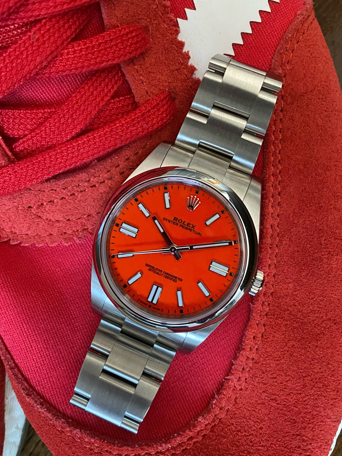 red rolex oyster perpetual with red adidas sneakers