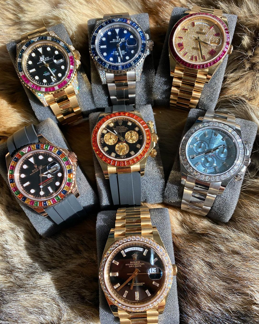 collection of jeweled Rolex watches