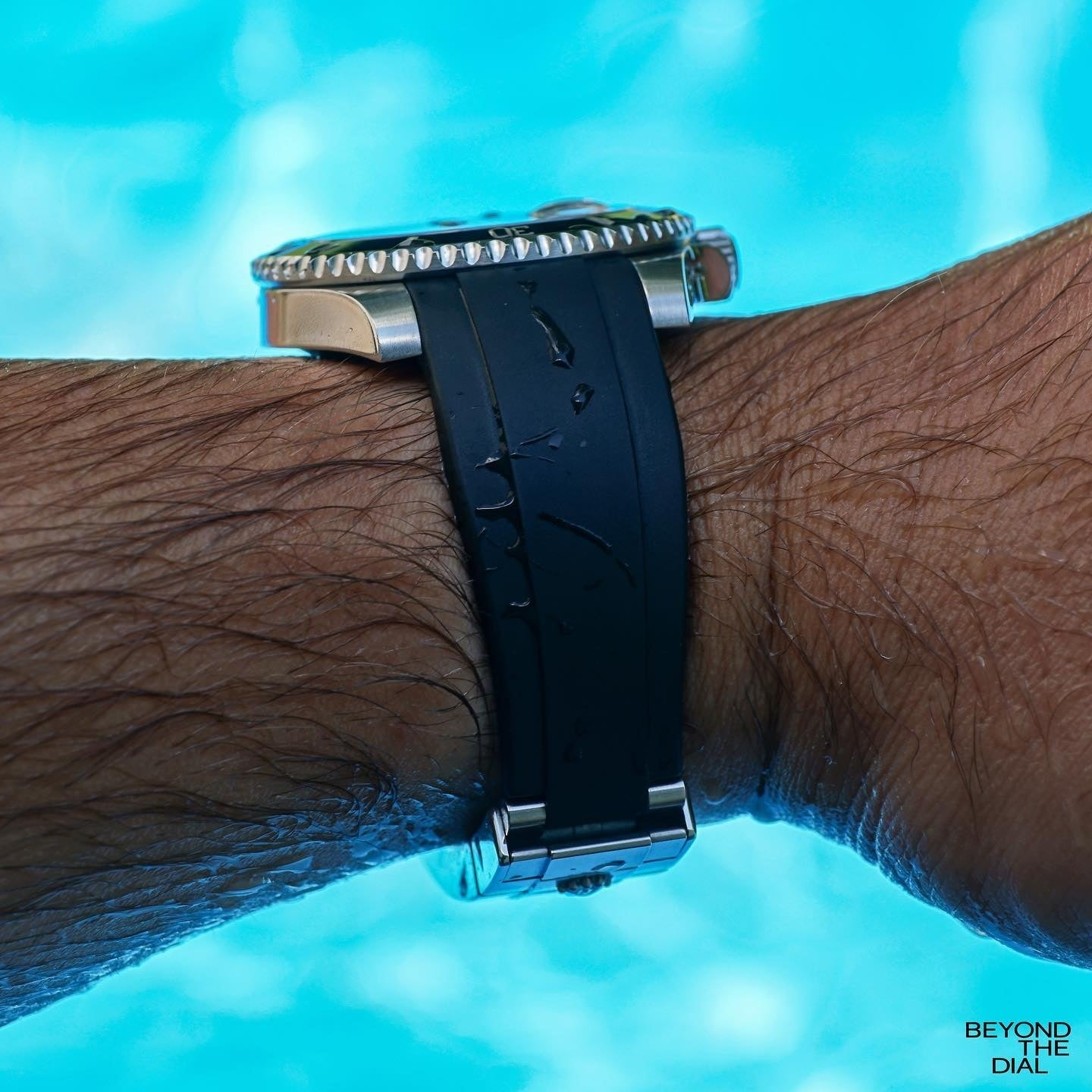 rolex submariner on black rubber everest bands in water